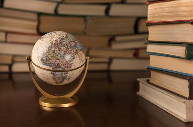 Book stacks and miniature globe